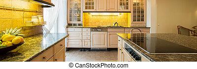Granitic countertop in kitchen