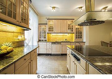 Granitic countertop in luxury kitchen