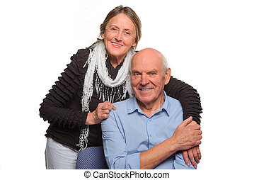 Granny embraces her husband. Smiling people dressed in casual style