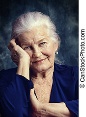 granny - Portrait of a beautiful smiling senior woman.
