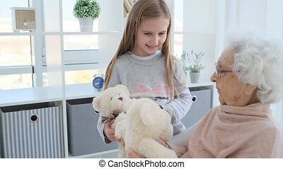 Granny playing with granddaughter
