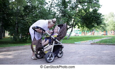 Granny playing with her grandson in the yard