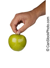 Granny Smith Apple - Green Granny Smith apple in a hand on a...