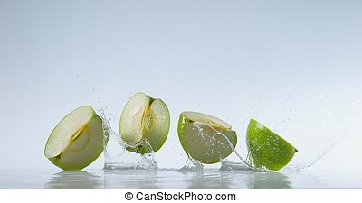 Granny Smith Apple, malus domestica, Fruit falling on Water,...