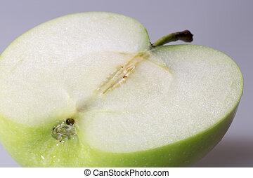 Granny Smith Apple sliced close up.