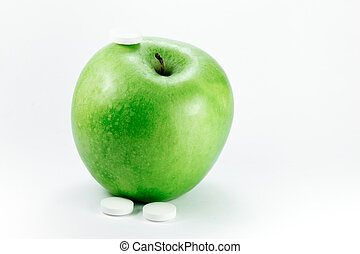 granny smith apple with pills