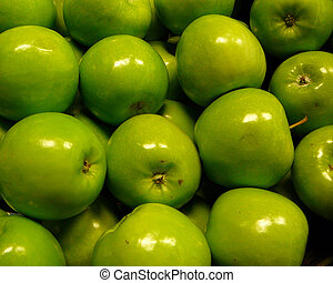 Granny Smith apples fill the frame.