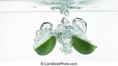 Granny Smith Apples, malus domestica, Fruit entering Water...