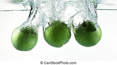 Granny Smith Apples, malus domestica, Fruits entering Water...