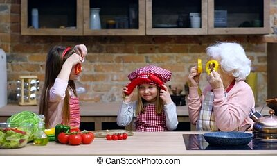 Granny with children at home kitchen