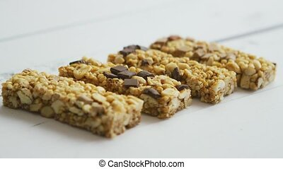 Granola bars with dried fruits wooden background - Homemade...