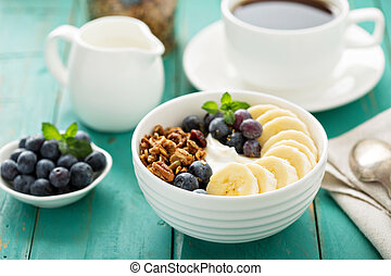 Granola bowl with yogurt and banana