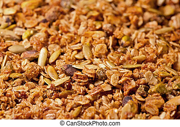 Close-up of homemade granola with rolled oats and pistachios.