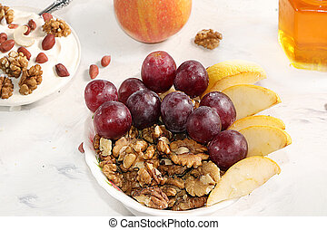 Granola, cottage cheese, apples and grapes on a light table. The concept of healthy and natural nutrition, diet healthy dessert. Healthy breakfast, funny food for children, lifestyle, I love my body.