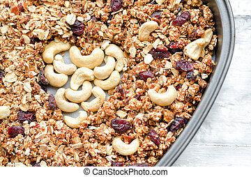 Granola in a baking dish, cashew in the shape of heart. Food concept. Close-up