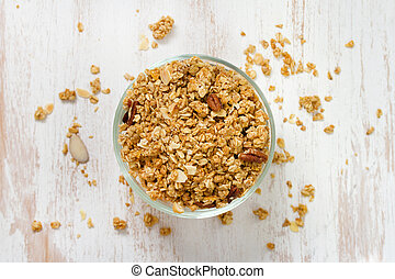 granola in bowl on white wooden background