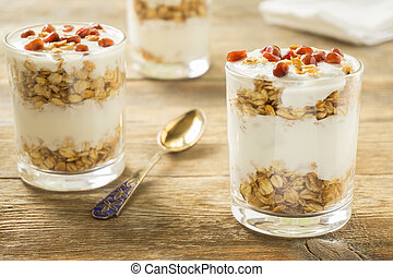 Granola in glasses with yoghurt and pomegranate