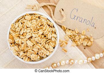 Granola in white bowl.