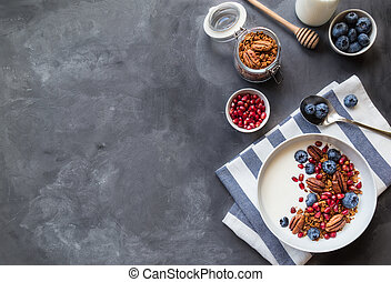 Granola, muesli with pomegranate seeds, blueberries and yogurt
