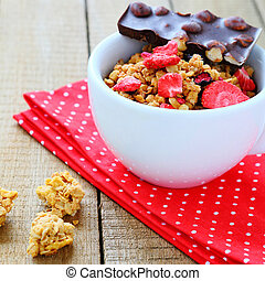 granola with dried strawberries and chocolate, food