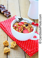 granola with dried strawberries, food closeup