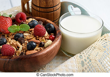 Granola with natural yogurt, fresh blueberries, nuts and honey, delicious breakfast or dessert. Healthy eating concept.