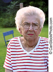 Granportrait 9 - Serious portrait of senior citizen woman at...