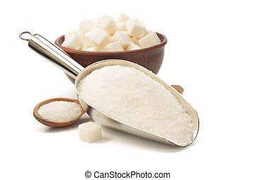 granulated sugar in scoop on white - granulated sugar in...