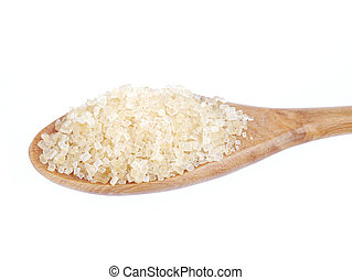 granulated sugar in spoon isolated on white background
