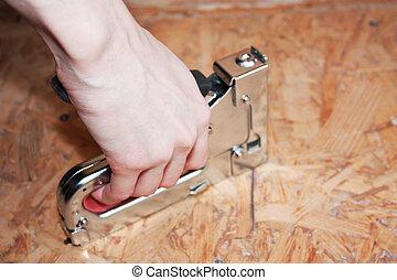 grapadora, trabajador construcción, mano