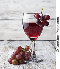 Grape and glass of red wine
