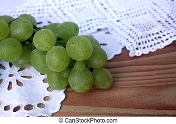 Grape cluster on a white tablecloth