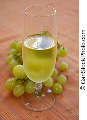 grape-harvest time. White wine and bunch of grapes