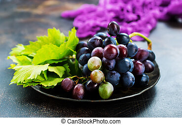 grape on plate and on a table