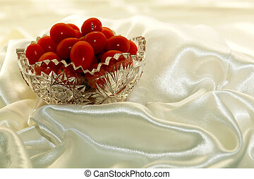 Grape Tomatoes - grape tomatoes in crystal bowl against soft...