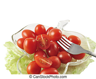 grape tomatoes in a dish on white background