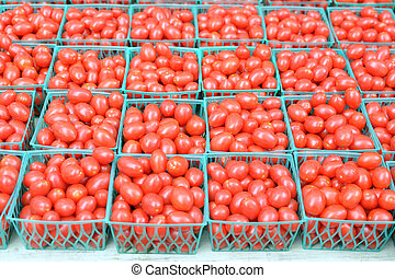 grape tomatoes on small buskets in farmers market