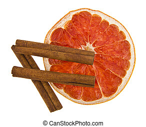 grapefruit and cinnamon isolated on white background
