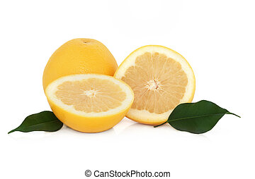 Grapefruit in half and whole, with leaf sprigs, isolated over white background.