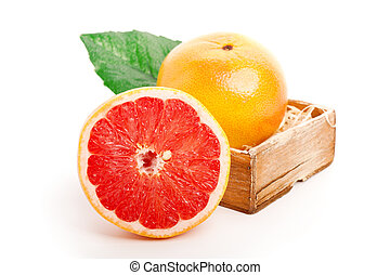 grapefruit in the wooden bowl. on white background