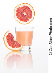 grapefruit juice in glass isolated on white background