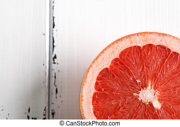 Grapefruit on white wooden background