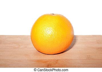 Grapefruit on wooden board