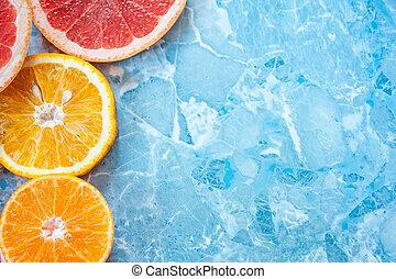 grapefruit, orange and tangerine on a blue background. Citrus texture