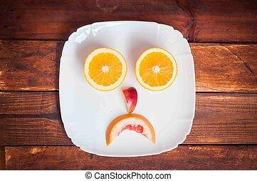 grapefruit, orange lemon cut on the table