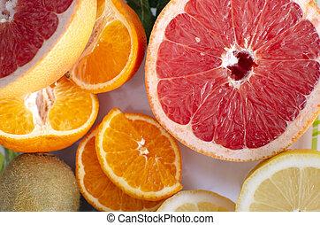 Grapefruit, orange, lemon, kiwi are on a white background