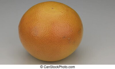 grapefruit  rotates on its axis. HD