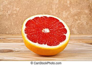 Grapefruit slice on wooden background
