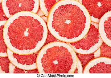 Grapefruit slices as background. Top view. Flat lay pattern