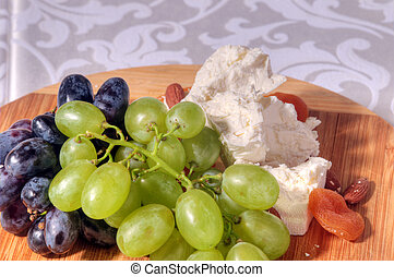 grapes and cheese on plate